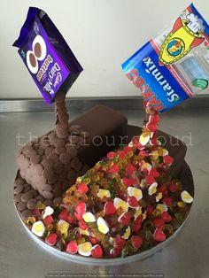 Haribos and chocolate buttons gravity defying birthday cake.