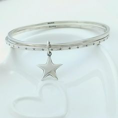 Brand new to my etsy shop. Set of 2 Sterling silver Star bangles.