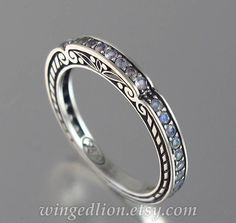This breathtaking wedding band was designed by the artist and jewelry designer Sergey Zhiboedov. It will be made to order in sterling silver in the