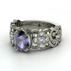 Mantilla ring from Gemvera: Oval Iolite Palladium Ring with Tanzanite & White Sapphire  Metal arcs like lace in the band of this detailed ring design by Jessica Behzad. $1,327