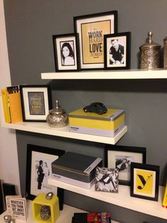 T: Like white shelves, gray walls, black frames. Pop of color-pink!  Shelves decoration using frames and personal graphics!