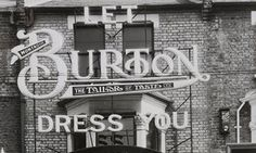 A Burton facade in East Ham, London, c1930s: 'In Leeds, it owned the largest clothing factory in Europe and the world's largest canteen, seating 8,000 workers.'
