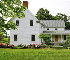 Farmhouse with a kitchen porch.