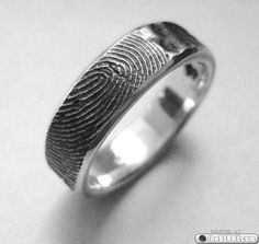 Fingerprint wedding ring!!  I might like this idea better than the one with the fingerprint inside the ring!!!