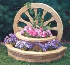 Google Image Result for http://www.amishtraditions.com/images/lawn_furniture/planter_wagon_wheel_lrg.jpg