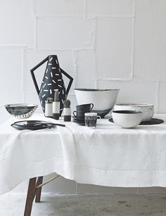 Whether bold and unexpected, or delicate and graceful, these handmade black and white ceramics makes a striking statement when it comes to laying a table. Homes & Gardens, August 2014. Photograph Katya de Grunwald. Styling Ali Brown.