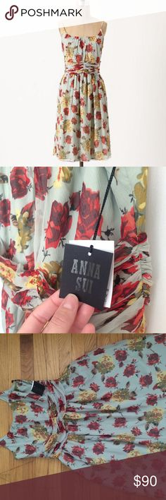 """RARE Anne Sui Silk Dress - Rose & Hortensia Gorgeous 100% silk Anna Sui for Anthropologie Dress. This is a Reposh as I bought other dresses I liked better on me. NWT-Designer tag but not Anthro tag. Beautiful mint/blue backdrop with floral bursts. Fully lined.  Cinched with a ruched cummerbund, Anna Sui's crinkled silk chiffon dress nips just so before flowing into an easy skirt.   Back zip  Silk; polyester lining  Dry clean  39""""L Anthropologie Dresses"""