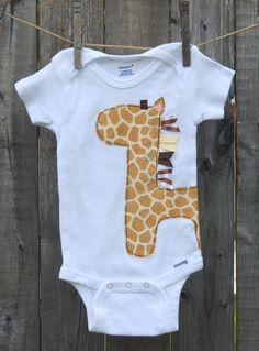 This onesie can be for a boy or girl. Its a perfect gift for those mamas who dont know that they are having. Giraffes are made with designer cotton fabric. Onesies make great baby shower and birthday gifts. Each item is handmade please allow up to a WEEK for creating. Thank You!  (Onesie in photo is 6-9 Months)    **Please Note: due the different sizes of the onesies applique placement may very slightly.**      ** Onesie is tagless and 100% cotton**    Sizes Available:    0-3 months…