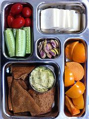 Avocado Hummus, while wheat pita chips, persimmon, veggies, Manchego & pistachios