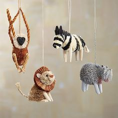 Natural fibers add fur-like texture and organic charm to these safari-inspired ornaments, including a zebra, lion, hippo and spider monkey.