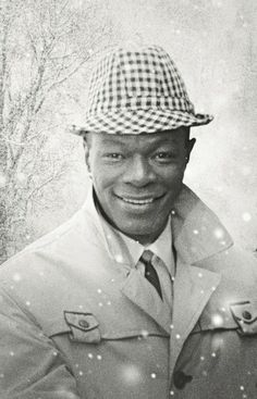 Nat King Cole. I believe this is the cover for one of his multiple Christmas albums...
