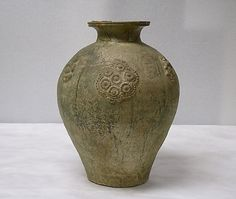 Jar    Period:      Six Dynasties, late Northern Dynasties (386–581)–Sui (581–618)  Date:      ca. late 6th century  Culture:      China  Medium:      Earthenware with applied relief decoration under green glaze