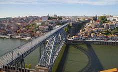 Dom Luís Bridge   The Dom Luís Bridge is a 172-metre (564 ft) long metal arch bridge that spans the Douro River between the cities of Porto and Vila Nova de Gaia in Portugal. Designed by Téophile Seyrig, construction was completed in 1886. Photograph: Diego Delso