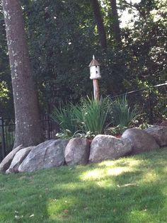 Rock border garden---center bird house