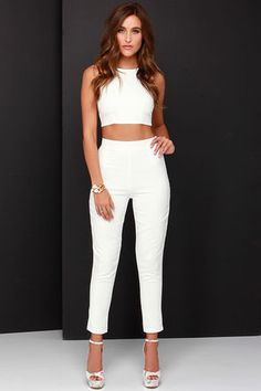 """As Seen On Ashleigh of The Daileigh blog! Happily ever after is what you will be when you unite with the Well-Suited Ivory Two-Piece Set! Sleek and oh-so-sexy, this silky woven set starts with a sleeveless crop top with a rounded neckline, side darting, plus cutouts, gold buckle and zipper closure at back. Strut your stuff in the matching high-rise trousers with a slightly tapered look. Pants have hidden side zipper with clasp. Small top measures 13.5"""" long. Small bottom measures 37.5"""" long."""