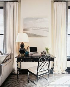 This small 'office' space sits beautifully within the larger living space because the black bamboo desk and chair are so elegant and perfectly proportioned.