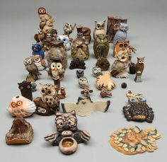 A selection of owl figurines.