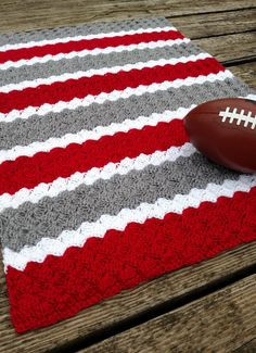 Beautiful Ohio State Buckeyes inspired Scarlet and Gray Striped Crochet Afghan! Available in multiple sizes from baby blanket size to full size bed! Want a custom size or different colors? Just message me! I love special orders! I am here to create your new favorite blanket! Makes a great gift or keep yourself warm whilst rooting for your Ohio State Buckeyes! This lovely handmade blanket is made using double crochet clusters in a scarlet, gray and white striped motif. Afghan is handmade by…