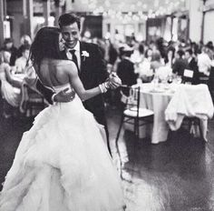 Love this shot of the first dance with the guests in the background. So beautiful!