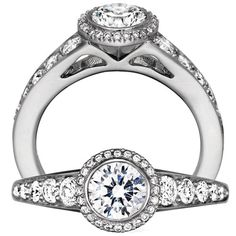 Bella Vita diamond engagement ring featuring a bezel set semi mount with a round cut centerstone that is surrounded by the Bella Vita design with micropavé set graduated diamond shank.