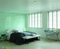 White wooden blinds with tapes in a contemporary lime bedroom.