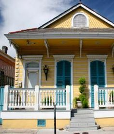 Shutters that actually close over the doors-19th Century Creole Cottages -