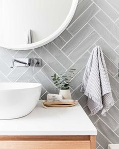Get the look: Contemporary vs. coastal bathrooms - badezimmer // bathroom - Double herringbone tile pattern – use conventional tiles but more modern feel than traditional su - Bathroom Renos, Budget Bathroom, Bathroom Wall Tiles, Bathroom Pink, Toilet Tiles, Cozy Bathroom, Bathroom Plants, Bathroom Cabinets, Bathroom Vanities