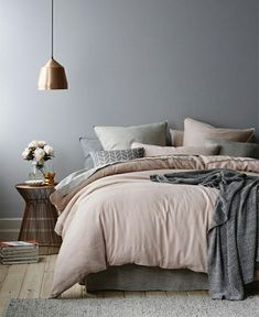 Pale pinks, light grey and barely nude... these hues combine to create a bedroom that is calm and soothing with just the right amount of colour.