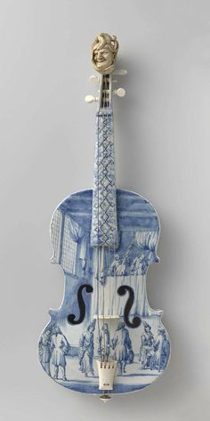 VIOLIN ~ Netherlands, 1705-1710. A magnificent musical instrument in shades of blue and white, painted to resemble Delft porcelain.