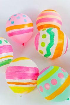 Globos pintados como huevos de Pascua : Decora y diviértete con los niños en esta manualidad de Pascua, convierte unos globos corrientes en huevos de Pascua gigantes. Necesitáis, además de los gl
