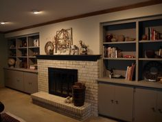 Brick fireplace, mantel, bookcases, cabinets and walls painted with Chalk Paint®. Country Grey on the fireplace and walls, French Linen for the cabinetry and Graphite on the mantel. Done by Studio 184 in Stoughton, WI. www.studio184stoughton.com #chalk paint® #painted brick #painted fireplace