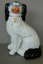 Staffordshire Disraeli Dog With Blue Eyes.  See this wonderful dog at www.antiquepooch.com.