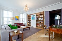 Bespoke shelving includes a sliding panel which covers the television and stereo system when you are entertaining guests