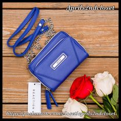 """KENNETH COLE REACTION Crossbody Clutch Wallet KENNETH COLE REACTION Crossbody Clutch Wallet 💟NEW WITH TAGS💟   * Vegan leather like exterior w/silver-tone logo & details  * Back detachable chain strap  * Dual zip around closures, an exterior back slip pocket, & an interior zip coin pocket, card slot & 8 slip pockets  * Approx. 4.5"""" H x 6.5"""" W x 1.75"""" D  * Approx. 24"""" strap drop   Material: PVC exterior & fabric lining Color: Blue  🚫No Trades🚫 ✅ Offers Considered*/Bundle Discounts✅ *Please…"""