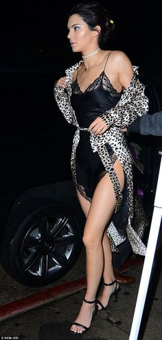 Bedroom ready: The Keeping Up With The Kardashians reality star added a flimsy leopard print duster and black heeled sandals