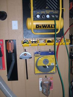 Wall-Mounted Air Compressor by David Grimes -- Homemade wall mounting for a small air compressor. Incorporates a hose reel to improve overall usability. http://www.homemadetools.net/homemade-wall-mounted-air-compressor-2