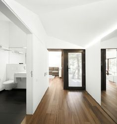 White walls timber floor  Timber flooring contrast with bathroom tile