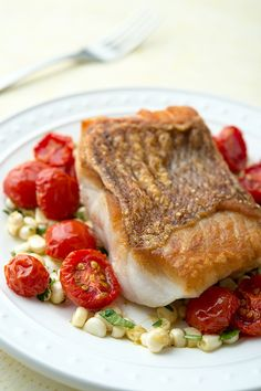 Red snapper with cherry tomatoes and fresh corn. This can be done with any white fish, by the way. Walleye, redfish and striped bass are perfect.