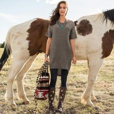 """THE CODY DRESS--It's easy to look fabulous in our effortless, knit dress with pockets. Cozy and casual, and perfect with boots and leggings. Hi-lo hem. Merino wool/nylon. Hand wash. Imported. Exclusive. Sizes XS (2), S (4 to 6), M (8 to 10), L (12 to 14), XL (16). Front approx. 33""""L."""