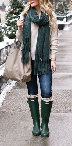 Green Hunter Boots and a jewel toned fringe scarf.