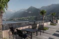 Apartment 7, Merano, is a breath of fresh air in every sense – dynamic architecture, modernist, monochrome interiors and a spectacular pool terrace furnished with Tribù chairs and loungers on the roof. #design #contemporary #inspiration