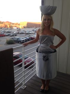 DIY Halloween costume: Stanley Cup. Make the hat out of styrofoam & a head band hot glued to the bottom and make the body out of a corset top and a circular pop up hamper! Cover it all in silver material by using safety pins and hot glue #halloween #costume #hockey #diy #college