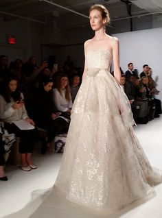 An embellished strapless wedding dress from @amsale | Brides.com