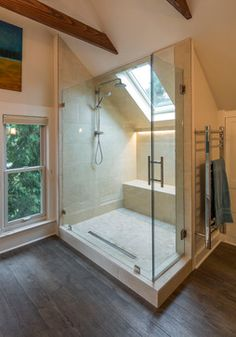 Ingenious skylight/ window above the shower! Have your shower under the sun or stars with the comforts of being inside. I wonder if you could open it up to let all the steam escape for no condensation problems.