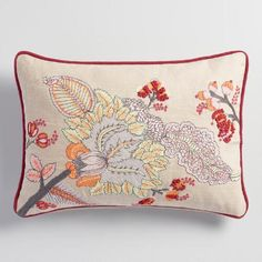 Embroidered with oversized flowers, our natural-toned, red-accented lumbar pillow blooms with rich texture and sunny style.