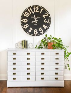 Learn how to turn a dated dresser into a vintage inspired apothecary cabinet! #furnituremakeover #diyfurniture #apothecarycabinet #cardcatalog #apothecarydresser #beforeandafter #paintedfurniture #grayfurniture