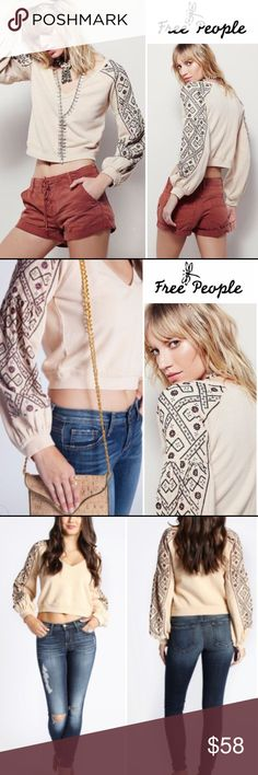 """Free People Casual Cotton Cropped Pullover #134-12 South-of-the-border-inspired embroidery adds vibrant color to the poufed raglan sleeves of a casual-cool cotton pullover with a slightly cropped silhouette. 20.5"""" length; Pit to pit 20""""  V-neck. Long raglan sleeves with rib-knit cuffs. 100% cotton. Dry clean or machine wash cold, tumble dry low. Free People Tops"""