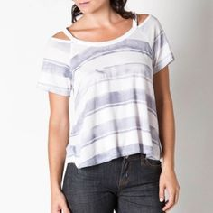 A twist on a classic oversized tee makes this easy breezy top just a bit sexy!