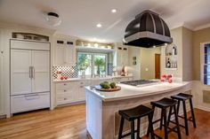 """White cabinets will complement almost any decor you want to choose — now or 20 years from now. """"To choose a style, consider the existing architecture of the home and how the cabinetry works visually within its environment,"""" says designer Tatiana Machado-Rosas of Jackson Design and Remodeling. """"A raised panel is often a good choice for more traditional styles, while a Shaker style (shown here) works with a modern, simple design."""""""