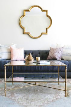 Nicolina Coffee Table by Lulu & Georgia! Enjoy our Nicolina Coffee Table as the crowning jewel to your living room. It's classy, feminine, reflective and delicate with the mirrored top, glass storage shelf, and gold leaf finish. Shop the look with L&G! #LANDGATHOME